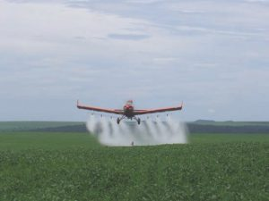 Embraer aircraft spraying soybeans