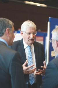 Swansea University Vice Chancellor Professor Richard Davies in discussion with Professor Tariq Butt and John Flaherty of Greenerpol